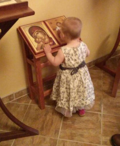Children rarely seem to need to be taught how to venerate icons. This photo is from St Anne Orthodox Church in Oak Ridge, Tennessee. The child-sized analogion was built by the rector, Fr. Stephen Freeman. Image by Magda Andronache.
